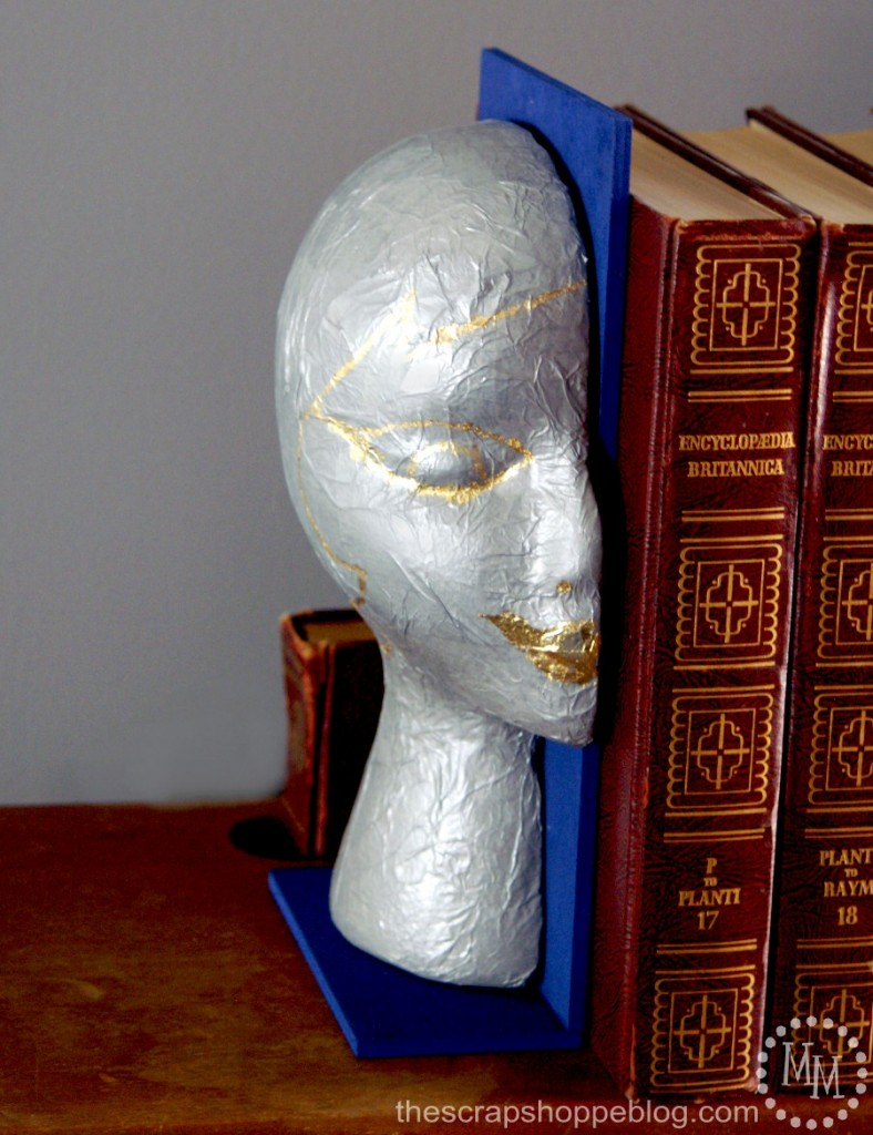 guilded-woman's-face-bookend