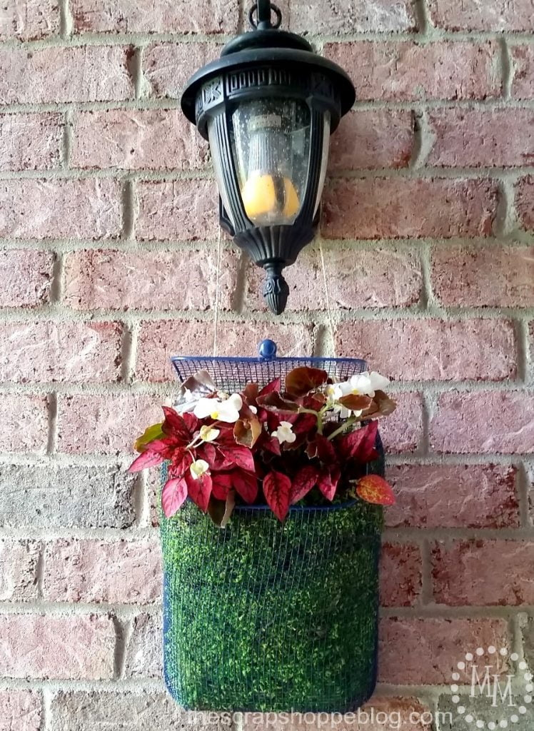 Old fashioned front porch mailbox turned flower planter