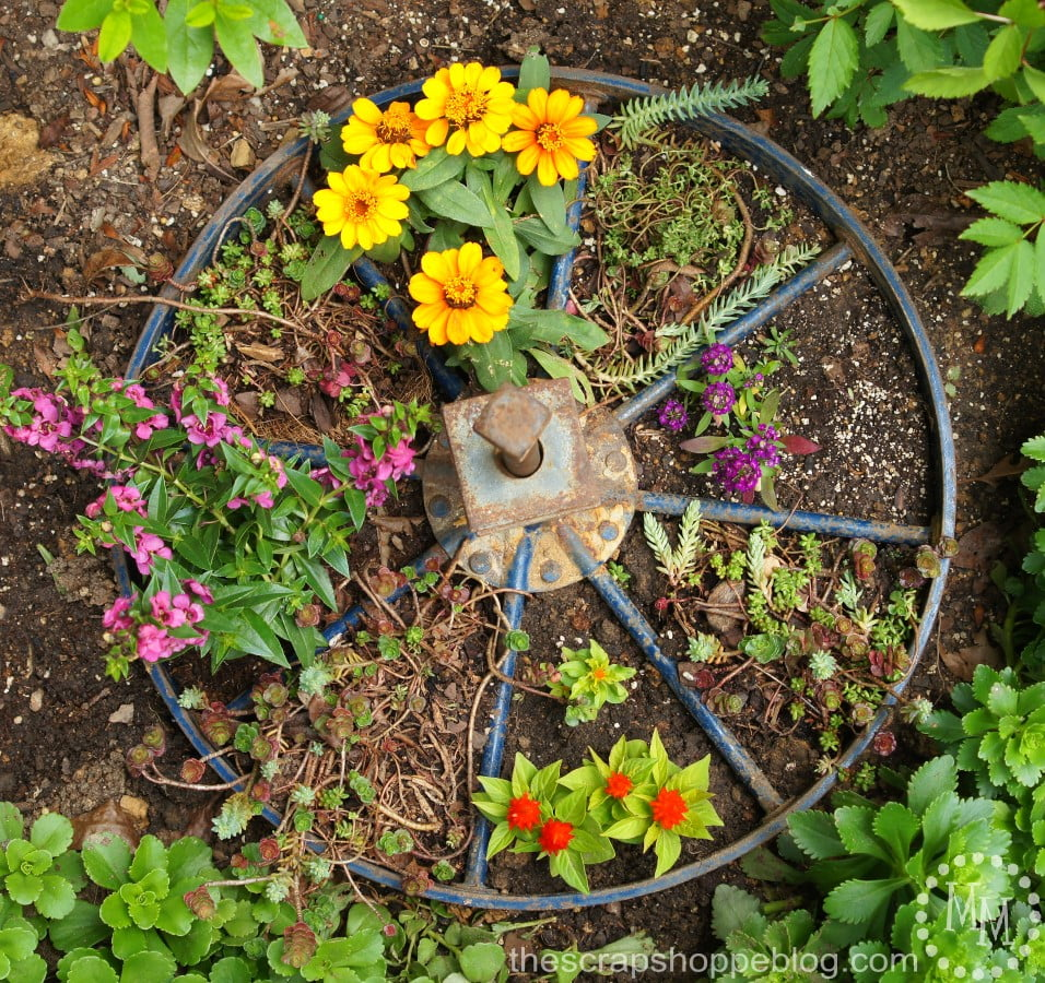 Wagon Wheel Planter - turn an old wagon wheel into a fun planter for the flower garden!