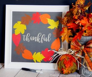 Use metallic vinyl on scrapbook paper to make a pretty wreath. Frame it and use it as a dry erase board to write what you're thankful for on!