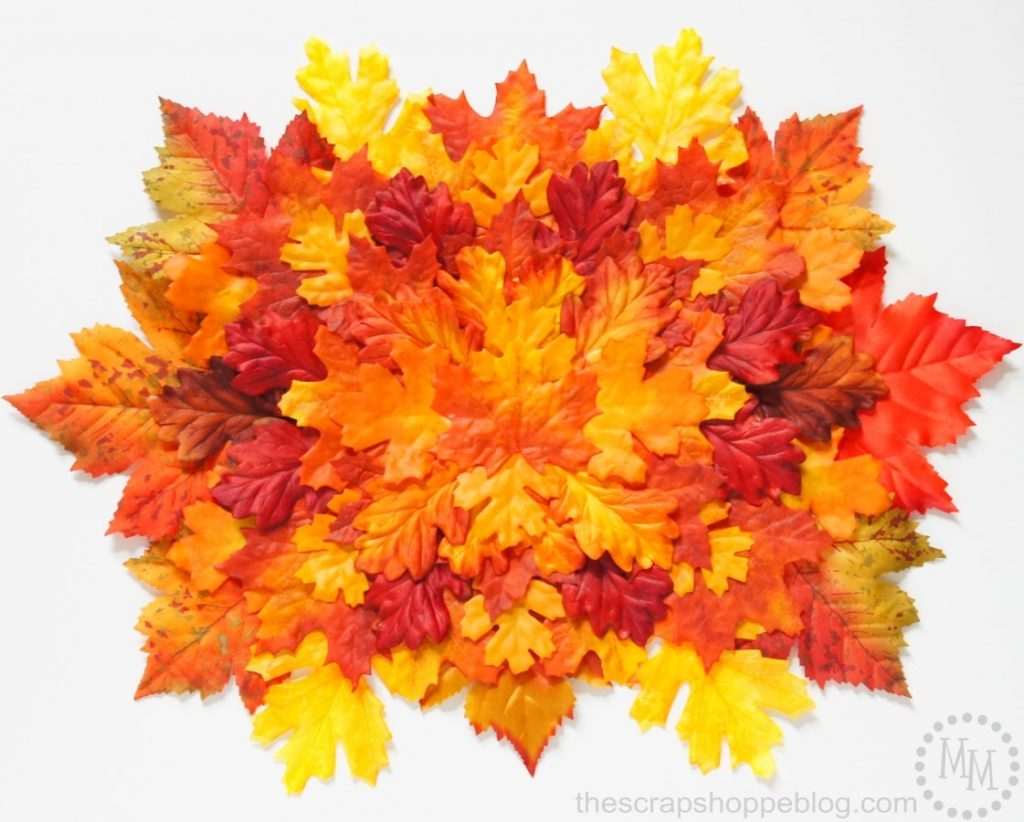 DIY your own leaf mat decor by layering faux leaves!