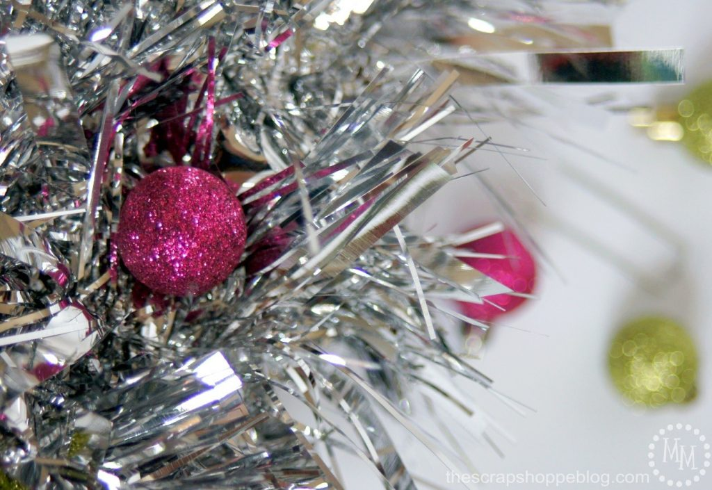 Giant tinsel garland make a fantastic vintage-looking wreath! Add vintage ornaments to complete the look.