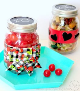Dress up Mason jars with pretty patterned duct tape and fill with a yummy treat to give your Valentine!