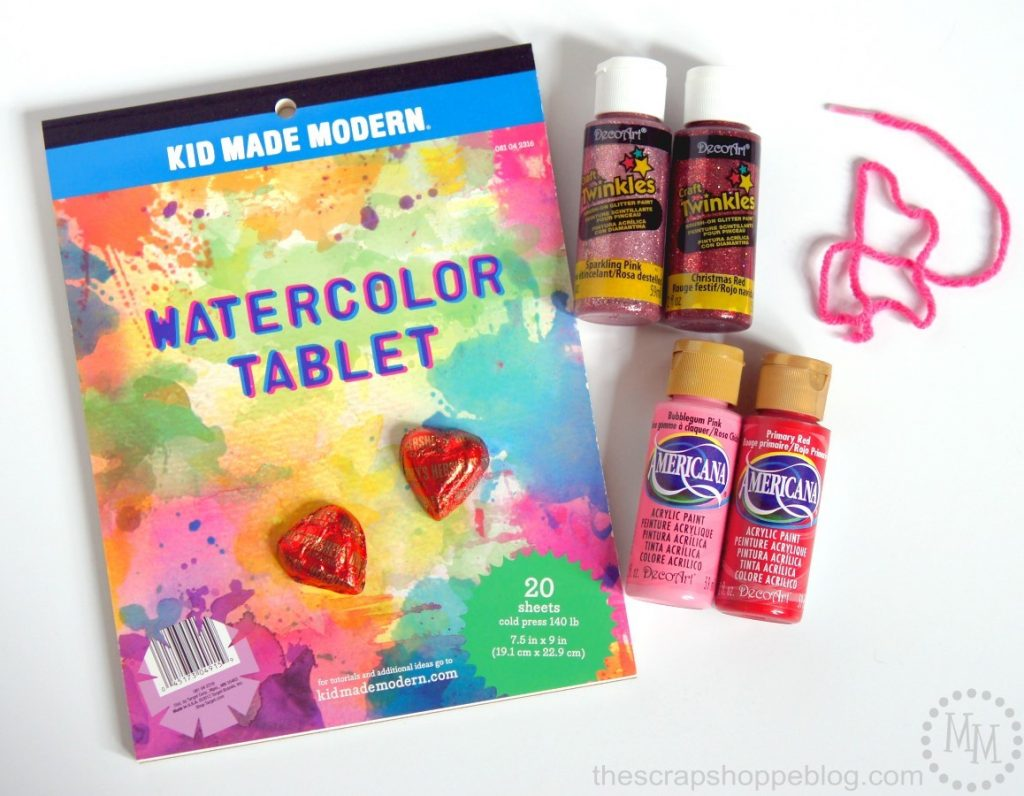 DIY your own watercolor Valentines stuffed full of chocolates with just a handful of supplies!