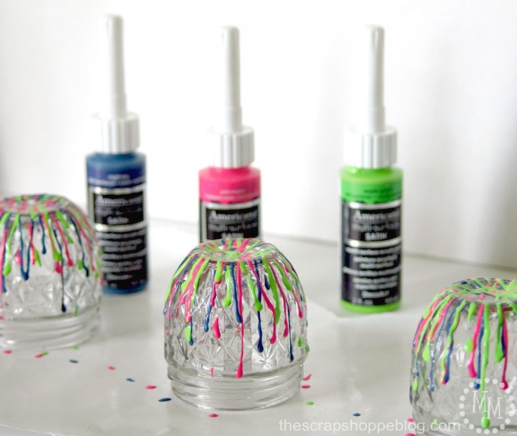 Get your desk organized in a bold way with some fun dripped paint storage jars!