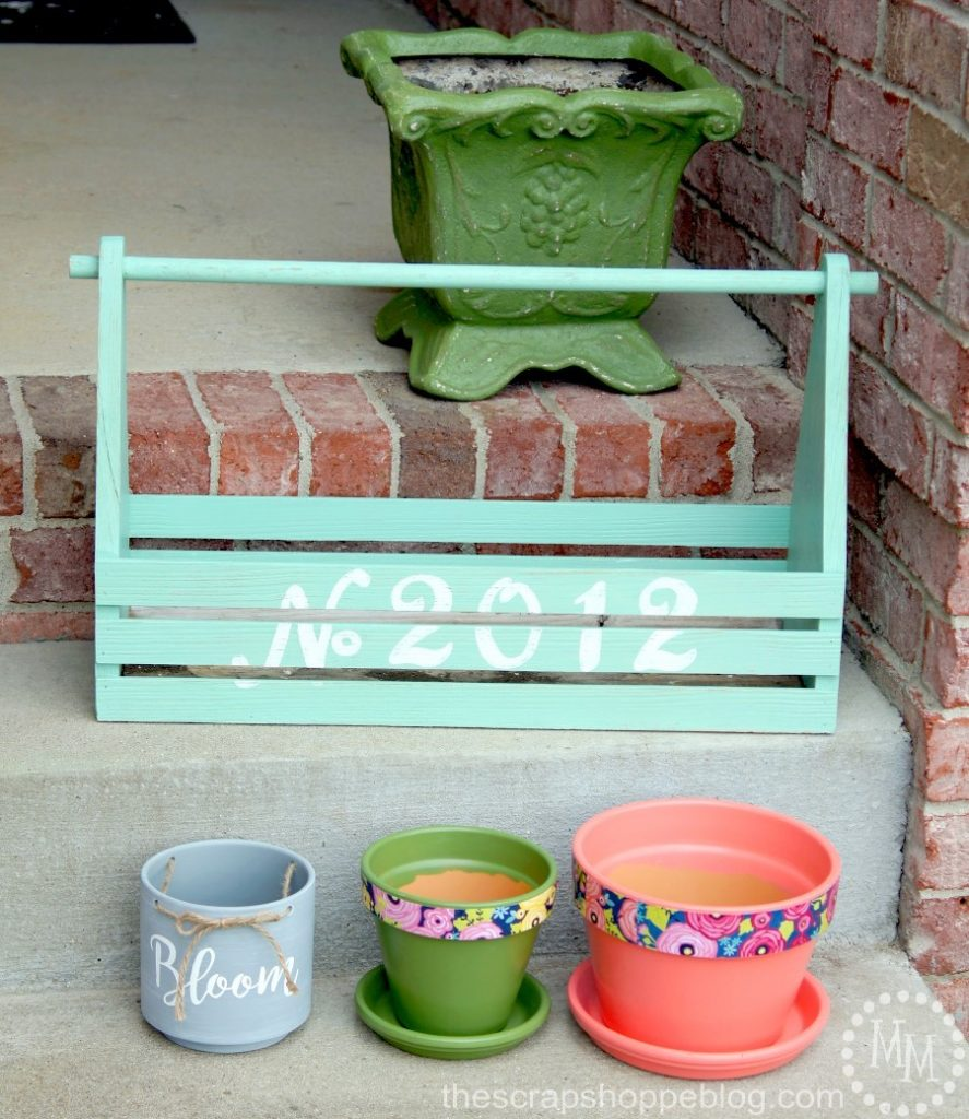 Update your front porch not just with fresh flowers, but with some fresh paint as well!