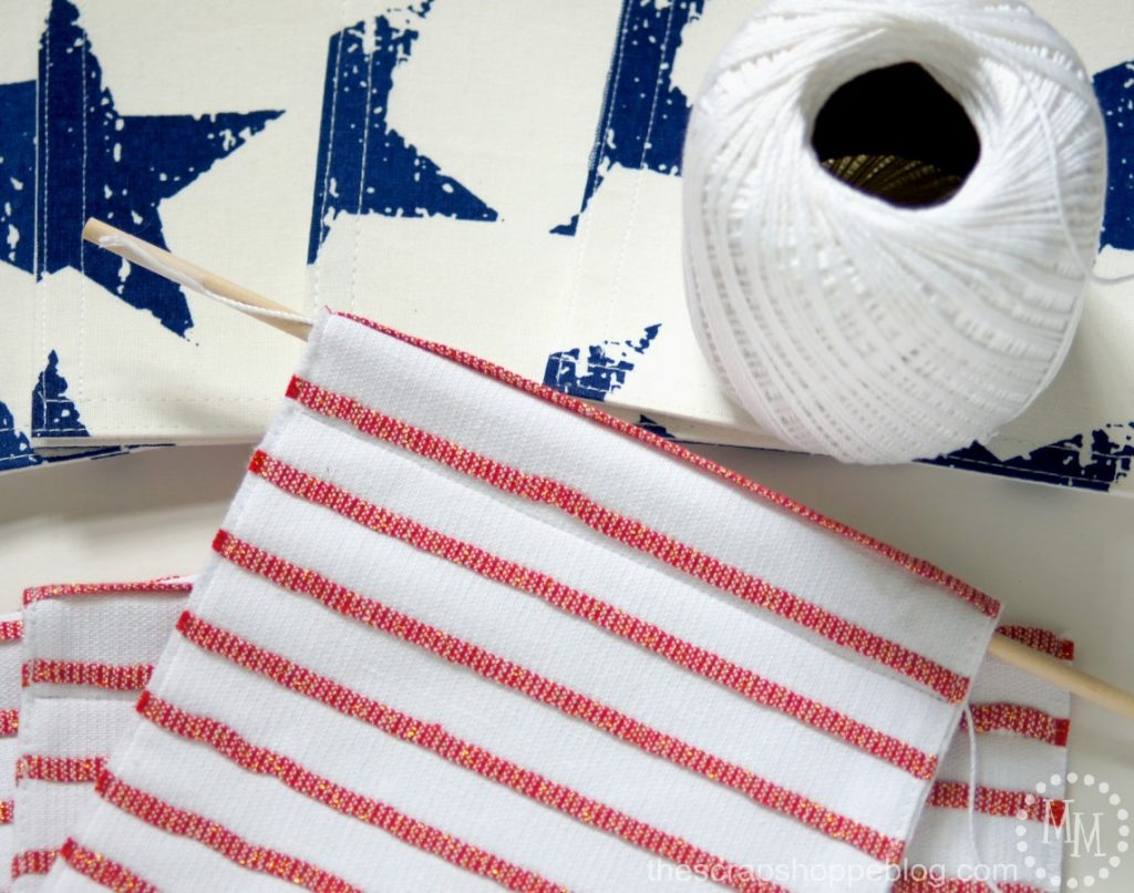 Super simple Stars & Stripes bunting for July 4th home decor - you won't believe what it's made from!