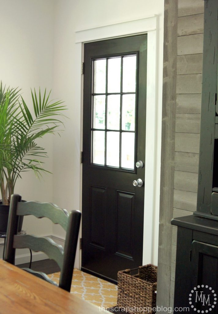 Painting a door black is a great way to achieve that farmhouse look!