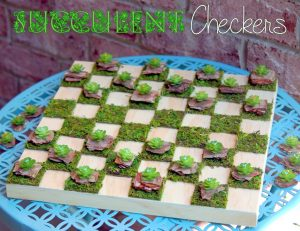Up your outdoor gaming with a moss and wood checkerboard and faux succulents as the checker pieces.