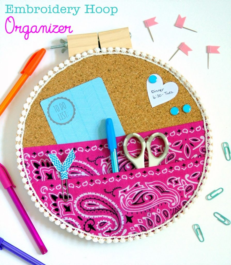 Take your organization UP off of your desk and onto your wall with an embroidery hoop organizer!