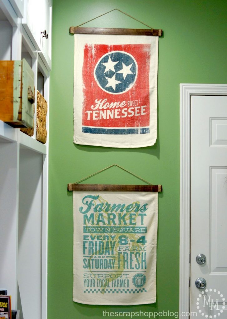 Hang fabric or paper wall decor with ease and with no holes in the material with these simple wooden wall hangers!