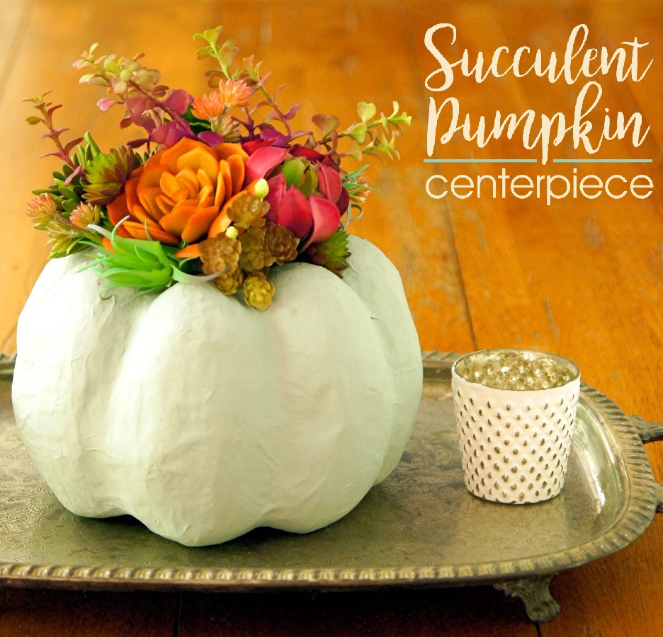 Make a stunning centerpiece using a painted paper mache pumpkins and faux succulents!
