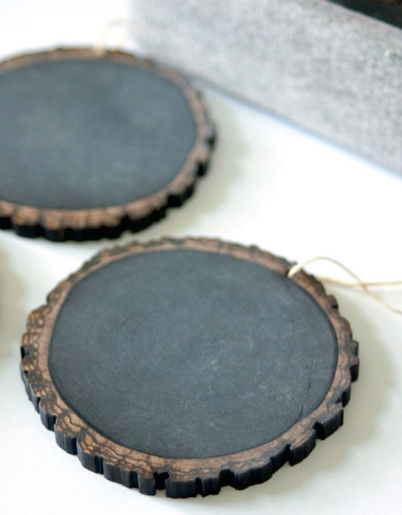 Cute little wood slice DIY holiday ornaments are a fun little gift idea and a great embellishment to add to gift wrap