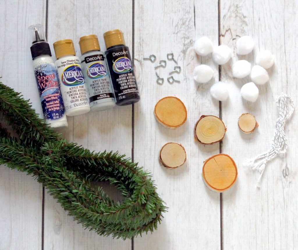 This DIY garland is woodsy and cozy and perfect for Christmas AND winter decor!